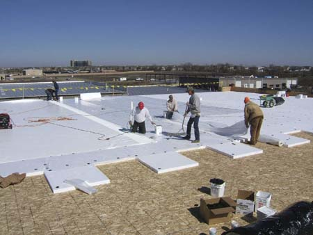 Wood Decking, Insulation, And Plastic Separator With 40 Mil Duro Last  Membrane Unfolding As Job Progresses.